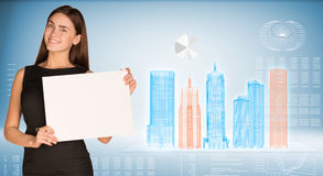 Businesswoman holding paper sheet Royalty Free Stock Photos