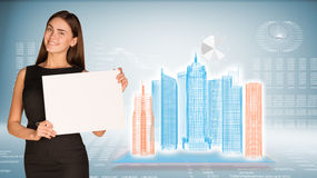 Businesswoman holding paper sheet Stock Images