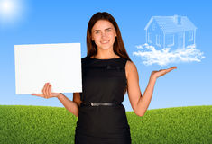 Businesswoman holding paper sheet and house of Royalty Free Stock Photography