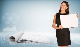 Businesswoman holding paper sheet Stock Photo