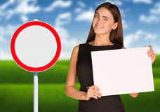 Businesswoman holding paper sheet Stock Image