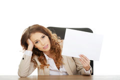 Businesswoman holding a paper sheet. Stock Image