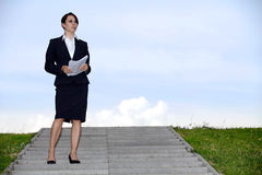 Businesswoman holding papers Stock Images