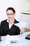 Businesswoman holding papers. Stock Photography
