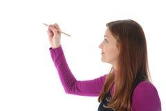 Businesswoman holding a pen Stock Photos
