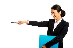 Businesswoman holding a pen and binder Royalty Free Stock Photo