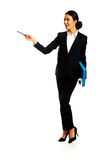 Businesswoman holding a pen and binder Royalty Free Stock Photography