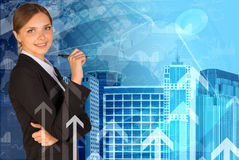 Businesswoman holding pen Stock Images