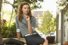 Businesswoman Holding Pen While Looking Away Stock Images