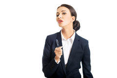 Businesswoman holding pen, looking at the camera Royalty Free Stock Image