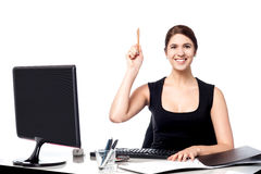 Businesswoman holding pen and raising her hand Royalty Free Stock Photography