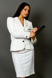 Businesswoman holding a pen requesting a signature on a document Stock Images