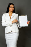 Businesswoman holding a pen Stock Photos