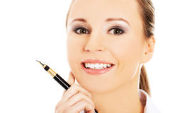 Businesswoman holding a pen Royalty Free Stock Photo