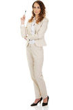 Businesswoman holding a pen. Stock Photography