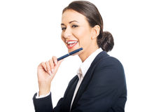 Businesswoman holding pen under chin Royalty Free Stock Image