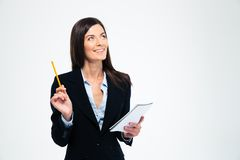 Businesswoman holding pencil with notebook Stock Photo