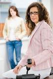Businesswoman holding phone Royalty Free Stock Photos