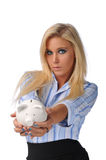 Businesswoman holding a piggy bank Stock Photo