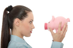 Businesswoman holding piggy bank Royalty Free Stock Image