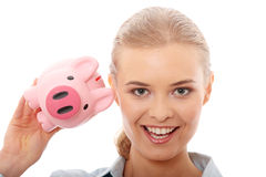 Businesswoman holding piggy bank Royalty Free Stock Photography