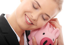 Businesswoman holding piggy bank Royalty Free Stock Photo