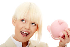 Businesswoman holding piggy bank Royalty Free Stock Photos