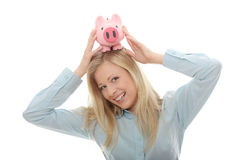 Businesswoman holding piggy bank Royalty Free Stock Images