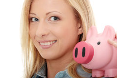 Businesswoman holding piggy bank Royalty Free Stock Photos