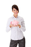 Businesswoman holding piggy bank Stock Images