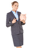Businesswoman holding a piggy bank Stock Photos