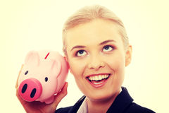 Businesswoman holding piggy bank Stock Photo
