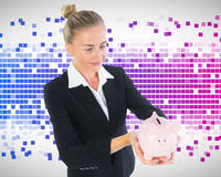 Businesswoman holding piggy bank Stock Photos