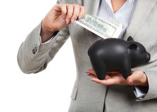 Businesswoman holding the piggy bank Stock Photos