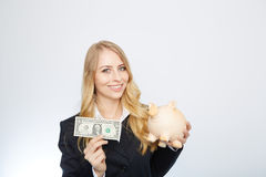 Businesswoman Holding Piggy Bank Stock Photography