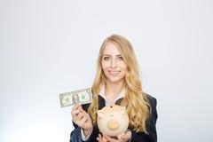 Businesswoman Holding Piggy Bank Stock Photography