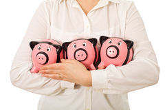 Businesswoman holding piggy-banks Stock Photography
