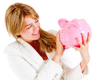Businesswoman holding a piggybank Stock Image