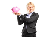 Businesswoman holding a piggybank Royalty Free Stock Photos
