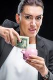 Businesswoman holding piggybank Royalty Free Stock Photos