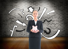 Businesswoman holding pink piggy bank Royalty Free Stock Photography