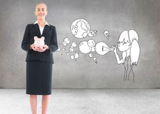 Businesswoman holding pink piggy bank Stock Image