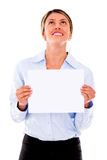 Businesswoman holding a placard Stock Image
