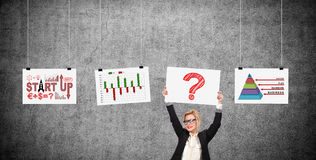 Businesswoman holding placard with drawing question mark Royalty Free Stock Photography