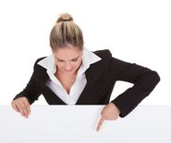 Businesswoman holding placard Royalty Free Stock Image