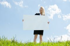 Businesswoman Holding Placard Royalty Free Stock Photography