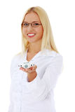 Businesswoman holding a plane toy. Stock Images