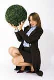 Businesswoman holding plant Royalty Free Stock Image