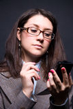 Businesswoman holding pocket computer Stock Photos