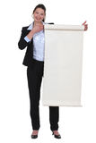 Businesswoman holding a poster Royalty Free Stock Photos
